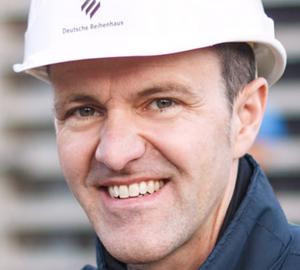 Porträt von Dr. Daniel Arnold, Beiratsvorsitzender und Gründungsgesellschafter der Cube Real Estate
